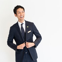 Relaxed young man in a suit smiling